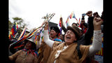 Backers of former President Evo Morales march in La Paz, Bolivia, Wednesday, Nov. 13, 2019. Bolivia's new interim president Jeanine Anez faces the challenge of stabilizing the nation and organizing national elections within three months at a time of political disputes that pushed Morales to fly off to self-exile in Mexico after 14 years in power. (AP Photo/Natacha Pisarenko)