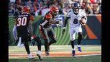 Baltimore Ravens quarterback Lamar Jackson (8) runs the ball for a touchdown against Cincinnati Bengals defensive end Carlos Dunlap (96) during the second half of NFL football game, Sunday, Nov. 10, 2019, in Cincinnati. (AP Photo/Frank Victores)