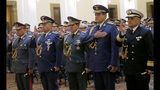 Bolivia's new Commander in Chief of the Armed Forces, Gen. Carlos Sergio Orellana Centellas, from left, Chief of Staff of the Command, Gen. Pablo Guerra Camacho, General Commander of the Army, Gen. Ivan Inchauste Rioja, Commander of the Bolivian Air Force Commander Ciro Orlando Alvarez and General Commander of the Navy, Orlando Mejia Heredia, right, take their oath of office from the opposition senator who has claimed Bolivia's presidency Jeanine Anez, during a swearing-in ceremony at the government palace in La Paz, Bolivia, Wednesday, Nov. 13, 2019. Anes faces the challenge of stabilizing the nation and organizing national elections within three months at a time of political disputes that pushed former President Evo Morales to fly off to self-exile in Mexico after 14 years in power. (AP Photo/Juan Karita)