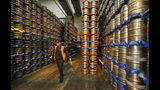 An employee walks past stored kegs of beer at Camerons Brewery in Hartlepool, England, Monday, Nov. 11, 2019. Political parties in Britain's Brexit-dominated December election are battling fiercely to win Hartlepool and places like it: working-class former industrial towns with voters who could hold the key to the prime minister's office at 10 Downing Street. (AP Photo/Frank Augstein)