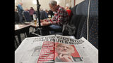 An article critical of Labour Party leader Jeremy Corbyn is displayed as people play bingo at the Hartlepool Working Men's club in Hartlepool, England, Sunday, Nov. 10, 2019. Britain's political parties are battling to win Hartlepool and places like it: working-class former industrial towns whose voters could hold the key to 10 Downing Street, the prime minister's office. Hartlepool has elected lawmakers from the left-of-center Labour Party for more than half a century. But in 2016, almost 70% of voters here backed leaving the European Union.(AP Photo/Frank Augstein)