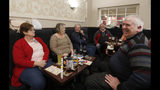 People talk at the Hartlepool Working Men's club in Hartlepool, England, Sunday, Nov. 10, 2019. Britain's political parties are battling to win Hartlepool and places like it: working-class former industrial towns whose voters could hold the key to 10 Downing Street, the prime minister's office. Hartlepool has elected lawmakers from the left-of-center Labour Party for more than half a century. But in 2016, almost 70% of voters here backed leaving the European Union. (AP Photo/Frank Augstein)