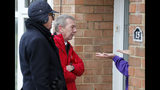 Labour candidate for Hartlepool Mike Hill, center, speaks to residents as he campaigns in residential areas in Hartlepool, England, Monday, Nov. 11, 2019. Hartlepool has elected lawmakers from the left-of-center Labour Party for more than half a century. But in 2016, almost 70% of voters here backed leaving the European Union. (AP Photo/Frank Augstein)