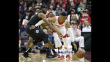 Houston Rockets' Russell Westbrook (0) keeps the ball from LA Clippers' Maurice Harkless during the first half of an NBA basketball game Wednesday, Nov. 13, 2019, in Houston. (AP Photo/David J. Phillip)