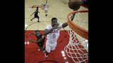 Houston Rockets' Clint Capela (15) shoots as LA Clippers' Kawhi Leonard defends during the first half of an NBA basketball game Wednesday, Nov. 13, 2019, in Houston. (AP Photo/David J. Phillip)