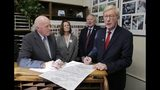 Republican presidential candidate former Massachusetts Gov. William Weld, right, files to have his name listed on the New Hampshire primary ballot, Wednesday, Nov. 13, 2019, in Concord, N.H. At left is New Hampshire Secretary of State Bill Gardner. (AP Photo/Charles Krupa)