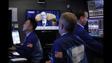Traders work on the floor of the New York Stock Exchange, Wednesday, Nov. 13, 2019, as House Intelligence Committee Chairman Adam Schiff, of Calif., delivers his opening remarks. Stocks are opening slightly lower on Wall Street led by declines in banks and industrial companies. (AP Photo/Richard Drew)