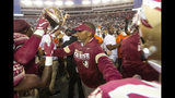 Florida State head coach Willie Taggart tries to keep his team from interacting with the Miami team after Miami beat Florida State 27-10 in an NCAA college football game in Tallahassee, Fla., Saturday, Nov. 2, 2019. Florida State fired second-year football coach Willie Taggart on Sunday, Nov. 3, less than 24 hours after the Seminoles lost to rival Miami and with the team in danger of missing a bowl game for the second consecutive season. (AP Photo/Mark Wallheiser)