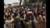 Mourners chant angry slogans as they carry the body of Islamic Jihad militant, Abdullah Al-Belbesi, 26, who was killed in Israeli airstrikes, during his funeral, in the town of Beit Lahiya, Northern Gaza Strip, Wednesday, Nov. 13, 2019. Gaza's Health Ministry said Wednesday that more Palestinians have been killed by ongoing Israeli airstrikes, bringing the death toll in the escalation over the past two days to at least 18. (AP Photo/Khalil Hamra)