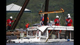 """FILE - In this July 23, 2018 file photo, a duck boat that sank in Table Rock Lake in Branson, Mo., is raised after it went down the evening of July 19 after a thunderstorm generated near-hurricane strength winds, killing 17 people. The National Transportation Safety Board on Wednesday, Nov. 13, 2019, released a """"Safety Recommendation Report"""" on the accident. The NTSB says the Coast Guard has repeatedly ignored safety recommendations that could have made tourist duck boats safer and potentially prevented the accident. (Nathan Papes/The Springfield News-Leader via AP, File)"""