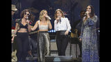 FILE - This April 1, 2019 file photo shows, from left, Amanda Shires, Maren Morris, Brandi Carlile, and Natalie Hemby of The Highwomen performing at Loretta Lynn's 87th Birthday Tribute in Nashville, Tenn. Morris will kick off the CMA Awards on Wednesday with her supergroup The Highwomen. (Photo by Al Wagner/Invision/AP, File)