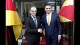 German Foreign Minister Heiko Maas, left, shakes hands with his North Macedonia's counterpart Nikola Dimitrov, right, upon his arrival at the foreign ministry in Skopje, North Macedonia, on Wednesday, Nov. 13, 2019. German Foreign Minister Maas arrived Wednesday in Skopje to discuss bilateral relations after North Macedonia failed to open European Union membership talks last month. (AP Photo/Boris Grdanoski)
