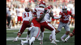 """FILE - In this Sept. 21, 2019, file photo, Ohio State defensive end Chase Young, left, sacks Miami (Ohio) quarterback Jackson Williamson causing a fumble during the first half of an NCAA college football game, in Columbus, Ohio. Ohio State says defensive end Chase Young won't play Saturday against Maryland because of a possible NCAA """"issue"""" in 2018. The surprising news was announced by the school with team's status report and depth chart for the coming game. The statement says Young is being held out because of a """"possible NCAA issue from last year"""" the athletic department is """"looking into."""" (AP Photo/Jay LaPrete, File)"""