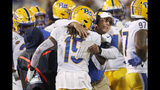 Pittsburgh head coach Pat Narduzzi embraces Pittsburgh defensive back Jason Pinnock (15) as he comes off the field in the second half of an NCAA college football game against the Georgia Tech Saturday, Nov. 2, 2019, in Atlanta. (AP Photo/John Bazemore)