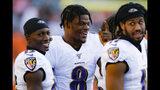 Baltimore Ravens quarterback Lamar Jackson, center, laughs on the sidelines during the second half of NFL football game against the Cincinnati Bengals, Sunday, Nov. 10, 2019, in Cincinnati. (AP Photo/Gary Landers)