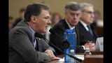 Top U.S. diplomat in Ukraine William Taylor, center, listens as career Foreign Service officer George Kent, testifies before the House Intelligence Committee on Capitol Hill in Washington, Wednesday, Nov. 13, 2019, during the first public impeachment hearing of President Donald Trump's efforts to tie U.S. aid for Ukraine to investigations of his political opponents. (AP Photo/Susan Walsh)