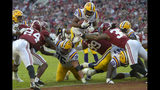 LSU running back Clyde Edwards-Helaire (22) dives over Alabama's Raekwon Davis (99) and Markail Benton (36) to score a touchdown in the first half of an NCAA college football game, Saturday, Nov. 9, 2019, in Tuscaloosa, Ala. (AP Photo/Vasha Hunt)