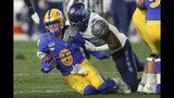 North Carolina defensive lineman Jason Strowbridge (55) tackles Pittsburgh quarterback Kenny Pickett (8) during the first half of an NCAA football game, Thursday, Nov. 14, 2019, in Pittsburgh. (AP Photo/Keith Srakocic)