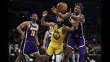 Los Angeles Lakers' Dwight Howard, right, grabs a rebound over Golden State Warriors' Ky Bowman (12) during the first half of an NBA basketball game Wednesday, Nov. 13, 2019, in Los Angeles. (AP Photo/Marcio Jose Sanchez)