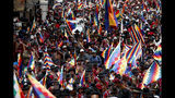 Backers of former President Evo Morales march in La Paz, Bolivia, Thursday, Nov. 14, 2019. Morales resigned and flew to Mexico under military pressure following massive nationwide protests over alleged fraud in an election last month in which he claimed to have won a fourth term in office. (AP Photo/Natacha Pisarenko)