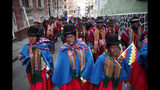 Supporters of former President Evo Morales march in La Paz, Bolivia, Thursday, Nov. 14, 2019. Morales resigned and flew to Mexico under military pressure following massive nationwide protests over alleged fraud in an election last month in which he claimed to have won a fourth term in office. (AP Photo/Natacha Pisarenko)