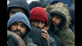 Migrants wait in line to receive supplies from the Red Cross at the Vucjak refugee camp outside Bihac, northwestern Bosnia, Thursday, Nov. 14, 2019. The European Union's top migration official is warning Bosnian authorities of a likely humanitarian crisis this winter due to appalling conditions in overcrowded migrant camps in the country. (AP Photo/Darko Vojinovic)