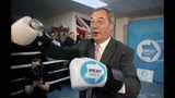 Brexit Party leader Nigel Farage, reacts, during a party rally, as part of General Election campaign trail, in Ilford, Essex, England, Wednesday, Nov. 13,2019. Britain goes to the polls on Dec. 12. (Joe Giddens/PA via AP)