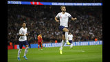 England's Harry Kane, right, celebrates scoring the fifth goal during the Euro 2020 group A qualifying soccer match between England and Montenegro at Wembley stadium in London, Thursday, Nov. 14, 2019. (AP Photo/Kirsty Wigglesworth)