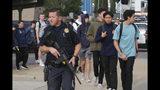 Students are escorted off of campus following a shooting at Saugus High School, Thursday, Nov. 14, 2015 in Santa Clarita, Calif. (David Crane/The Orange County Register via AP)