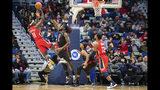 New Orleans Pelicans guard Jrue Holiday (11) scores against the Los Angeles Clippers during the first half of an NBA basketball game in New Orleans, Thursday, Nov. 14, 2019. (AP Photo/Sophia Germer)