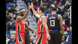 New Orleans Pelicans guard Jrue Holiday (11) and guard JJ Redick (4) high-five after Holiday scored on the Los Angeles Clippers during the first half of an NBA basketball game in New Orleans, Thursday, Nov. 14, 2019. (AP Photo/Sophia Germer)