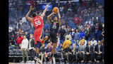 New Orleans Pelicans guard E'Twaun Moore (55) jumps up as Los Angeles Clippers guard Lou Williams (23) passes the ball to a teammate during the first half of an NBA basketball game in New Orleans, Thursday, Nov. 14, 2019. (AP Photo/Sophia Germer)