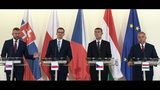Slovak Prime Minister Peter Pellegrini, left, speaks as his counterparts Mateusz Morawiecki of Poland, 2nd left, Andrej Babis of Czech Republic, 2nd right, and Viktor Orban of Hungary, right, look on during the Visegrad Group (V4) press conference before the Summit of Cohesion Friends in Prague, Nov. 5, 2019. (Ondrej Deml/CTK via AP) SLOVAKIA OUT