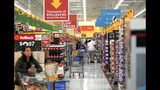 FILE- In this Nov. 9, 2018, file photo shoppers walk through the isles at a Walmart Supercenter in Houston. Walmart Inc. reports earnings Thursday, Nov. 14, 2019. (AP Photo/David J. Phillip, File)