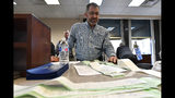 Anderson County Clerk Jason Denny looks over the printouts from the voting machines during the remcanvass of the results from the election for Kentucky Governor in Lawrenceburg, Ky., Thursday, Nov. 14, 2019. Election officials across Kentucky have started double-checking vote totals that show Republican Gov. Matt Bevin trailing Democrat Andy Beshear by more than 5,000 votes. (AP Photo/Timothy D. Easley)