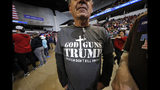 Dennis Mjaseth of Keatchie, La., displays a message on his shirt before a campaign rally for President Donald Trump in Bossier City, La., Thursday, Nov. 14, 2019. (AP Photo/Gerald Herbert)