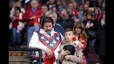 A man dressed as Evel Knievel prays with a boy prays during the invocation at the start of a campaign rally for President Donald Trump in Bossier City, La., Thursday, Nov. 14, 2019. (AP Photo/Gerald Herbert)