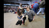 "Dennis Kees, left, of Shreveport, La., attends a campaign rally for President Donald Trump with his dog ""Big Joe"" in Bossier City, La., Thursday, Nov. 14, 2019. (AP Photo/Gerald Herbert)"