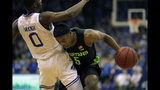 Michigan State guard Cassius Winston (5) is called for a foul against Seton Hall guard Quincy McKnight during the first half of an NCAA college basketball game Thursday, Nov. 14, 2019, in Newark, N.J. (AP Photo/Adam Hunger)