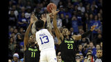 Seton Hall guard Myles Powell (13) passes over Michigan State forward Xavier Tillman (23) and Michigan State forward Aaron Henry (11) during the first half of an NCAA college basketball game Thursday, Nov. 14, 2019, in Newark, N.J. (AP Photo/Adam Hunger)