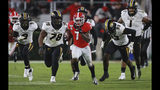 Georgia tailback D'Andre Swift (7) makes a long gain for a first down against Missouri during the third quarter of an NCAA college football game Saturday, Nov. 9, 2019, in Athens, Ga. (Curtis Compton/Atlanta Journal Constitution via AP)