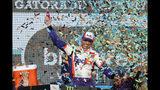 Denny Hamlin celebrates in Victory Lane after winning the NASCAR Cup Series auto race Sunday, Nov. 10, 2019, in Avondale, Ariz. (AP Photo/Ralph Freso)