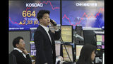 A currency trader talks on the phone at the foreign exchange dealing room of the KEB Hana Bank headquarters in Seoul, South Korea, Thursday, Nov. 14, 2019. Asian stock markets were mixed Thursday amid doubts about the status of a U.S.-Chinese trade deal after the U.S. Federal Reserve's chairman said it is likely to leave its benchmark interest rate unchanged. (AP Photo/Ahn Young-joon)
