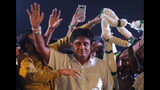 FILE - In this Monday, Nov. 11, 2019, file photo, presidential candidate of Sri Lanka's governing party Sajith Premadasa waves to supporters during a rally in Negombo, Sri Lanka. Premadasa entered the fray after an open rebellion against his party leader Prime Minister Ranil Wickremesinghe, rallying support by pledging to boost welfare programs and by embracing disgruntled party stalwarts. (AP Photo/Eranga Jayawardena, File)