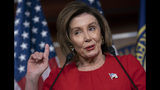 """Speaker of the House Nancy Pelosi, D-Calif., talks to reporters on the morning after the first public hearing in the impeachment probe of President Donald Trump on his effort to tie U.S. aid for Ukraine to investigations of his political opponents, on Capitol Hill in Washington, Thursday, Nov. 14, 2019. Pelosi says the president's actions in the impeachment inquiry amount to """"bribery."""" (AP Photo/J. Scott Applewhite)"""