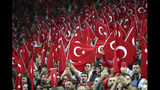 Fans of Turkey national soccer team wave flags during the Euro 2020 Group H qualifying soccer match between Turkey and Iceland in Istanbul, Thursday, Nov. 14, 2019. (AP Photo)