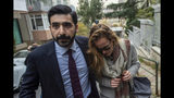"""Emma Hedvig Christina Winberg, the wife of British army officer James Le Mesurier who co-founded the """"White Helmets"""" volunteer organization in Syria, leaves after being questioned by Turkish police, in Istanbul, Wednesday, Nov. 13, 2019. The Istanbul chief prosecutor's office said Tuesday an autopsy and other procedures were underway at Istanbul's Forensic Medicine Institute to determine """"the exact cause"""" of Le Mesurier's death. (AP Photo)"""