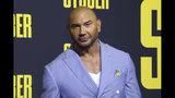 """FILE -In this July 10, 2019, file photo, Dave Bautista attends the LA Premiere of """"Stuber"""" at the Regal LA Live on Wednesday, July 10, 2019, in Los Angeles. A Florida animal shelter sent out a desperate plea after someone had abandoned two pit bull dogs. But volunteers never expected the post would catch the attention of actor Bautista. The 6-year-old pit bulls, Maggie and Ollie, were handed over to the county after their owner had a baby. (Photo by Willy Sanjuan/Invision/AP, File)"""