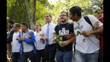 Venezuelan opposition leader, and self-proclaimed interim president of Venezuela, Juan Guaido, center, walks with students at the Central University of Venezuela after a meeting with them in Caracas, Venezuela, Thursday, Nov. 14, 2019. Guaido is calling people across the crisis-torn nation to flood the streets for protests nearly a year since launching an urgent campaign to push President Nicolás Maduro from power. (AP Photo/Ariana Cubillos)