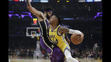 Golden State Warriors' D'Angelo Russell (0) is defended by Los Angeles Lakers' JaVale McGee during the first half of an NBA basketball game Wednesday, Nov. 13, 2019, in Los Angeles. (AP Photo/Marcio Jose Sanchez)